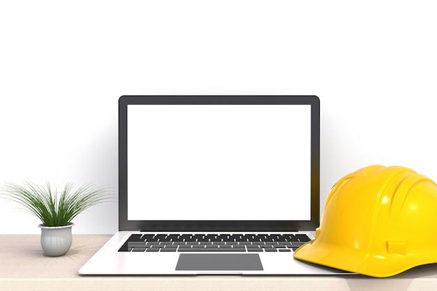 Защитный шлем с ноутбуком белый пустой экран на деревянном столе передний рабочий стол Premium Фотографии