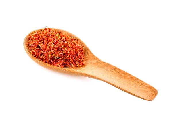 Safflower dried in wood spoon