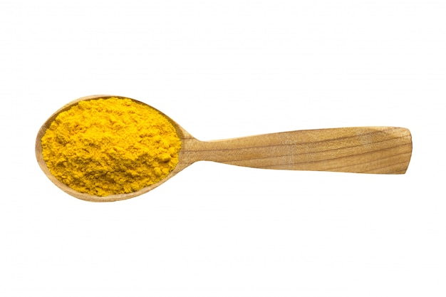 Saffron powder in wooden spoon isolated on white background. spice for cooking food, top view.