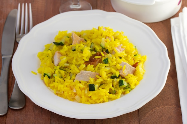 Saffron rice with pork on the white plate