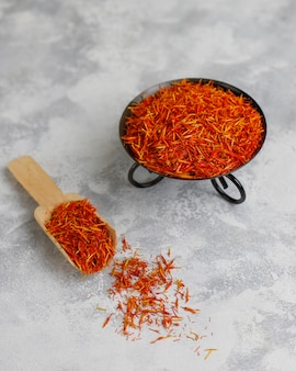 Saffron spice herb in wooden spoon