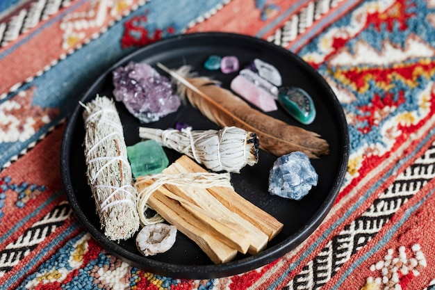 Sage and crystals on a ceramic plate ready for smudging