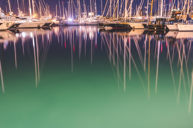 Sail boats and yachts in the harbour at night