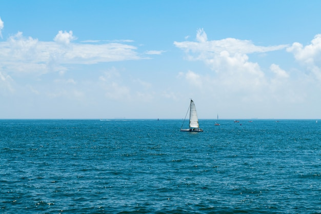 A sailboat drifting on the sea