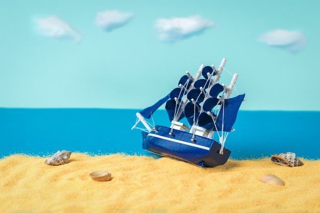 A sailboat stranded on the sand on the seashore. the concept of travel and adventure.