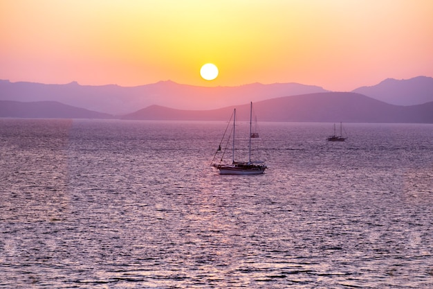 Sailboats at sunset. beautiful sea sunset background.