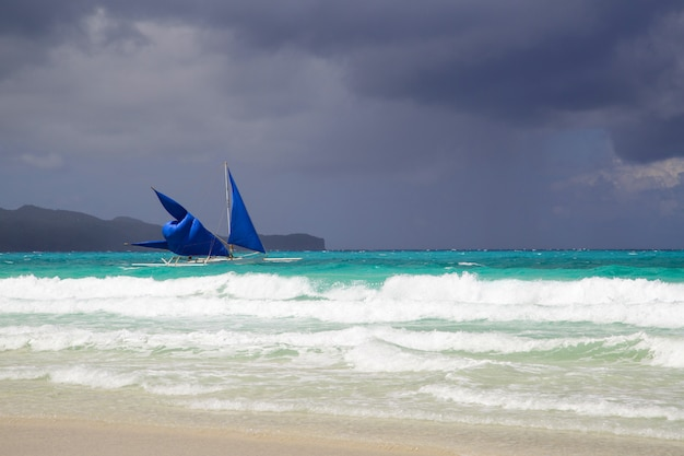 Sailing boat on the sea at boracay island before storm, philippines