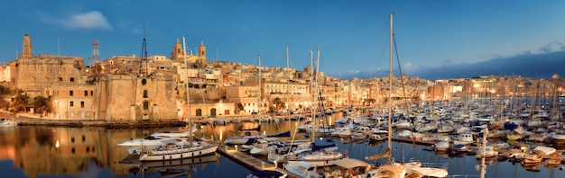Sailing boats on senglea marina in grand bay, valetta, malta, at night