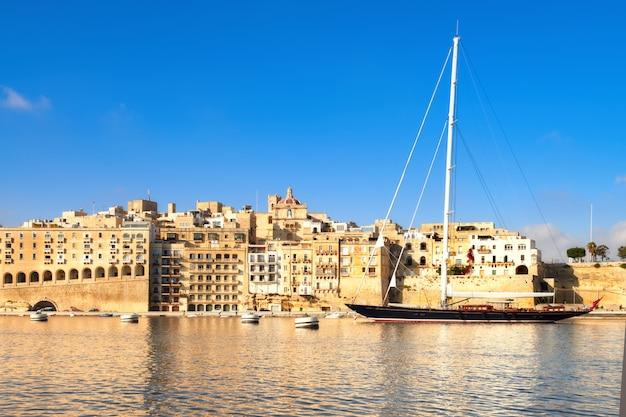 Sailing ship enters grand valetta bay, malta