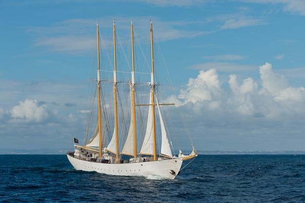 Sailing ship with four white sails