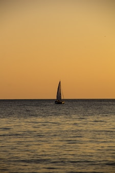 Sailing yacht in the sea at sunset. black sea.