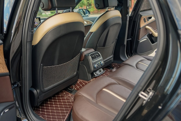 Saint petersburg, russia-august 18, 2021: the interior of the audi a6 car is black, the driver's seat is brown and beige leather