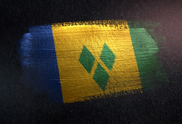 Saint vincent and the grenadines flag made of metallic brush paint on grunge dark wall