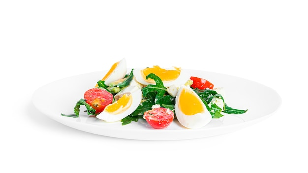 Salad of arugula, avocado, cherry tomatoes and eggs isolated on a white background. green salat. vegetarian salad. high quality photo