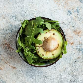 Salad of avocado, arugula, sesame seeds. healthy diet. vegetarian dishes.