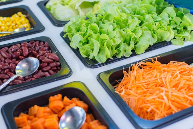 Salad bar is a healthy food consists of various types of fresh vegetables sliced