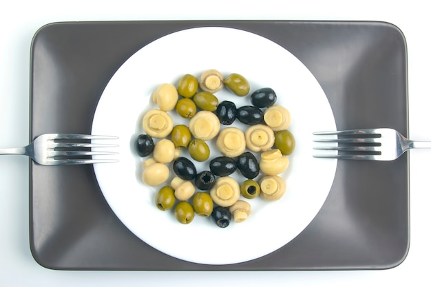 Salad of black and green olives on a plate.