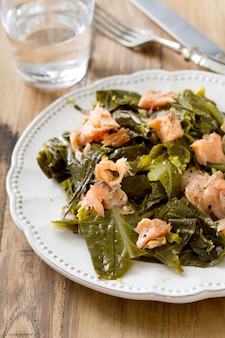 Salad cabbage with smoked salmon on plate