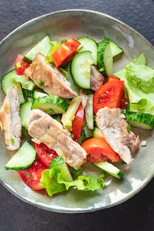 Salad chicken breast meat vegetable tomato cucumber lettuce diet food meal snack on the table Premium Photo