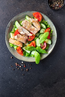 Salad chicken meat breast vegetable tomato cucumber lettuce diet food meal snack on the table