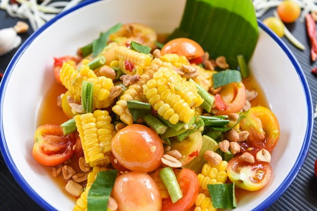 Salad corn spicy with fresh vegetables herbs