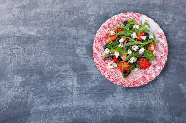 Salad of fresh strawberries. snack on summer parties.