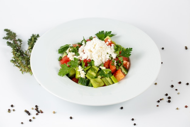 Salad of fresh vegetables with tomato and cheese