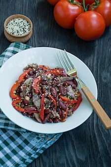 Salad from beef and beans, bell pepper.