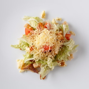 Salad from vegetables and meat on a white background