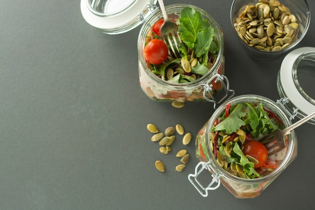Salad in glass jar with fresh vegetables,chick pea and pumpkin seeds.