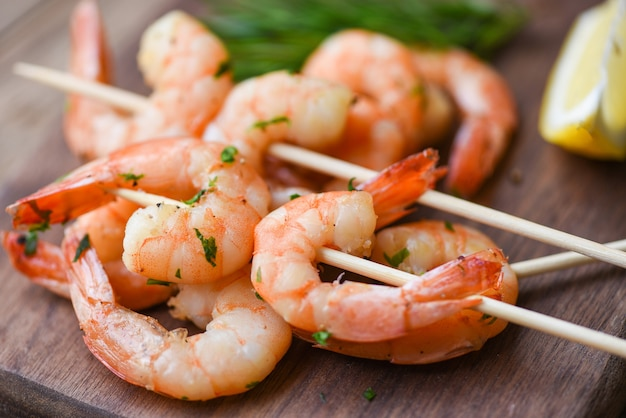 Salad grilled shrimp skewers delicious seasoning spices on wooden plate appetizing cooked shrimps baked prawns
