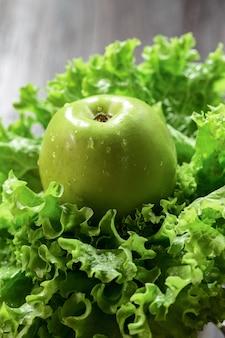 Salad leaves and green apple  on wood