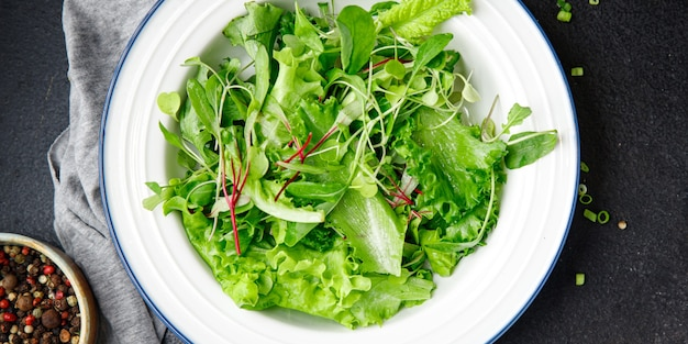 Salad leaves mix fresh herbs petals vitamin aperitif fresh ready to eat meal snack on the table