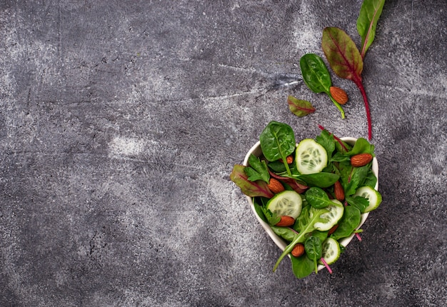 Salad mix with cucumber and almond. healthy food concept. selective focus