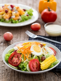 Salad on the wooden table background