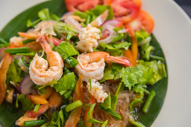 Salad on a plate with prawns