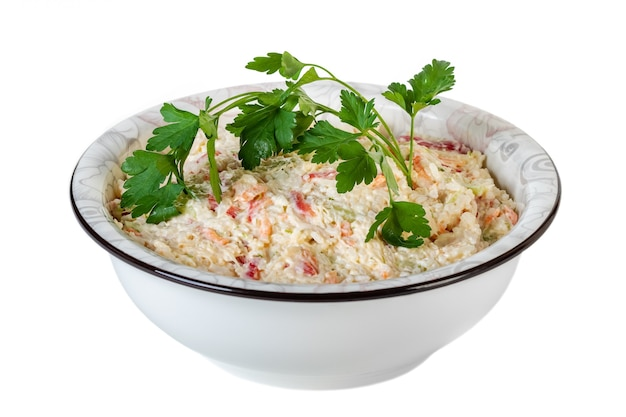 Salad of rice, vegetables with mayonnaise in a bowl isolated on white