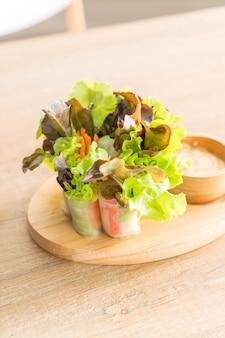 Salad roll on wood plate