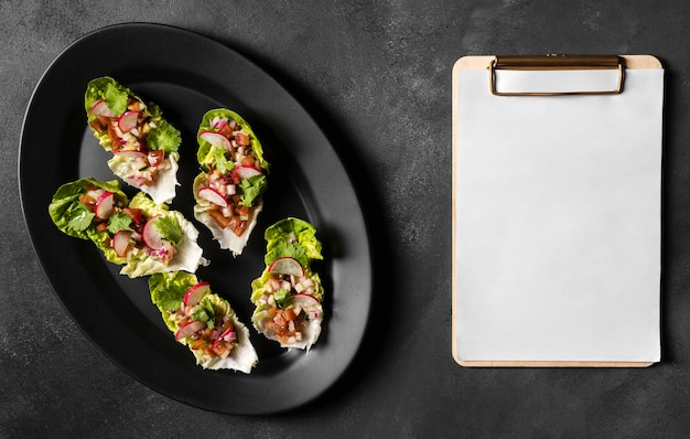 Salad on slices of bread and copy space clipboard
