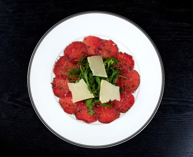 Salad topped with cheese and greenery