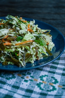 Salad of white cabbage, sea kale and fresh carrots seasoned with olive oil