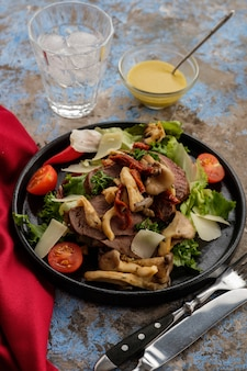 Salad with beef and oyster mushrooms