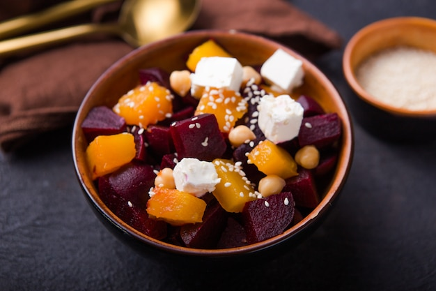 Salad with beet,  feta, and pumpkin,  keto ketogenic dash diet, modern surface , closeup