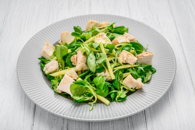 Salad with chicken grilled with lettuce