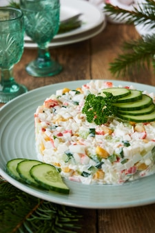 Salad with crab sticks, vegetables, rice and eggs
