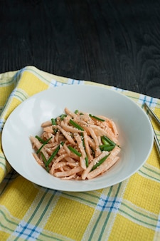 Salad with daikon radish, green onions, honey and red chili powder. asian salad. flat lay.