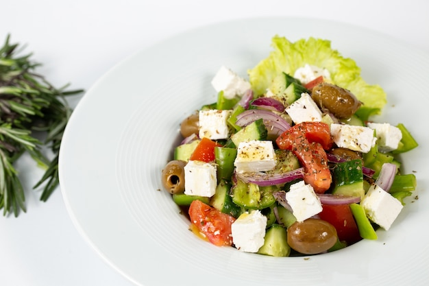 Salad with feta cheese olives and fresh vegetables