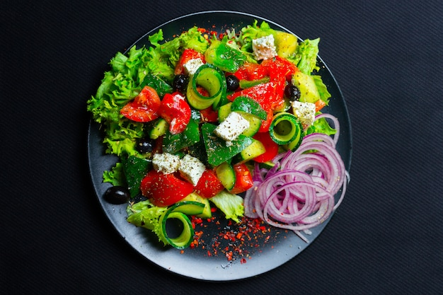 Salad with feta cheese. top view. free space for your text.