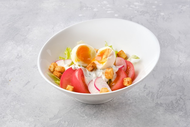 Salad with fresh tomato near radish and boiled egg