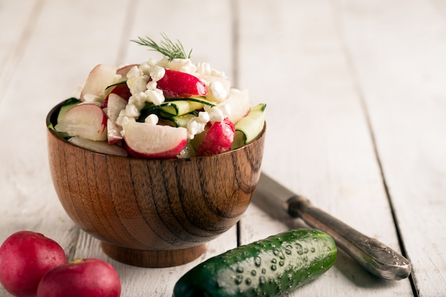 Salad with fresh vegetables and cottage cheese, copy space